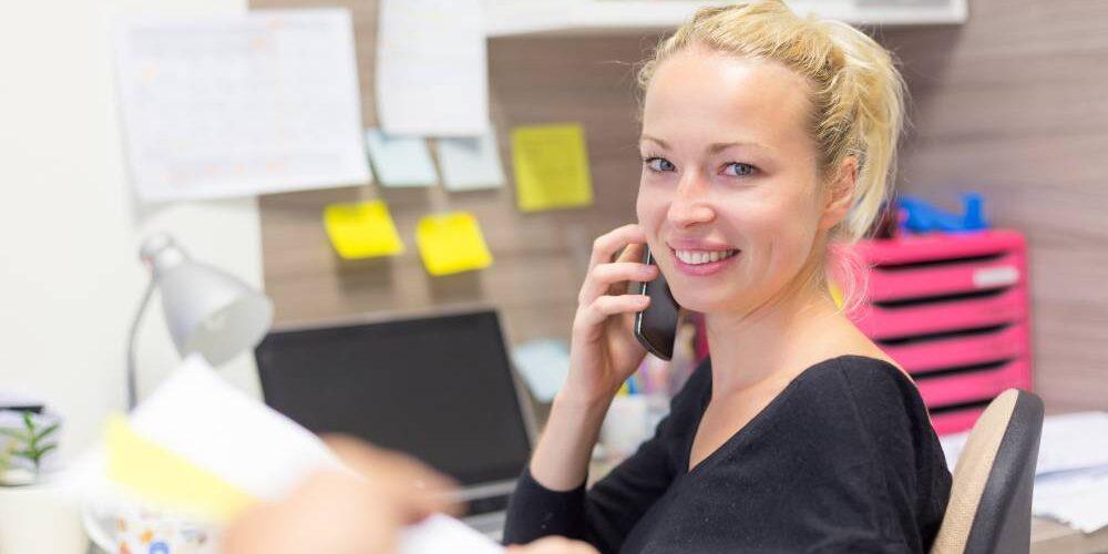 bookkeeper making phone calls